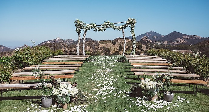 Lilla &amp; Steve - <p>The Dome &amp; Camp Cabernet, Malibu</p>  <p>Lush greens and white blooms were accompanied by a multitude of potted plants, natural wood, hemstitched linens, and an abundance of freshly picked fruits and vegetables to give this beach cities couple the organic easiness they desired.</p>